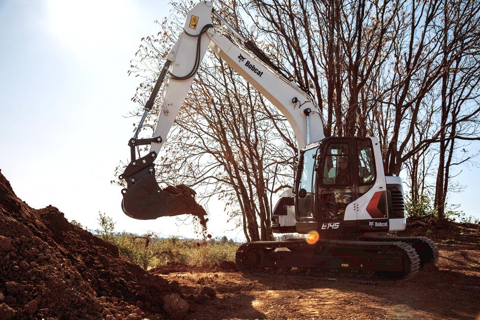 Operator Moves Dirt With Bobcat Large Excavator