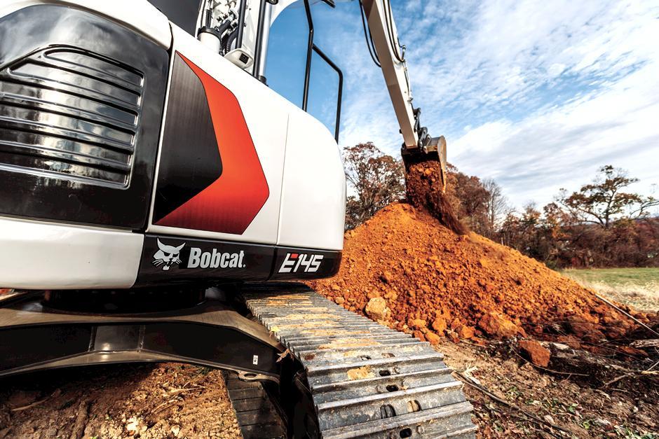 Bobcat 14-16T Size Class Large Excavator Lifting Material Across Jobsite