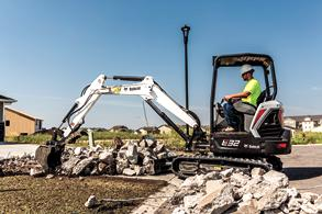Bobcat compact excavator moving rocks
