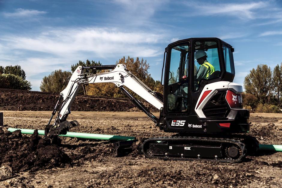 Operator Moving Concrete Material With Bobcat E35 Mini Excavator And Grapple Excavator Attachment
