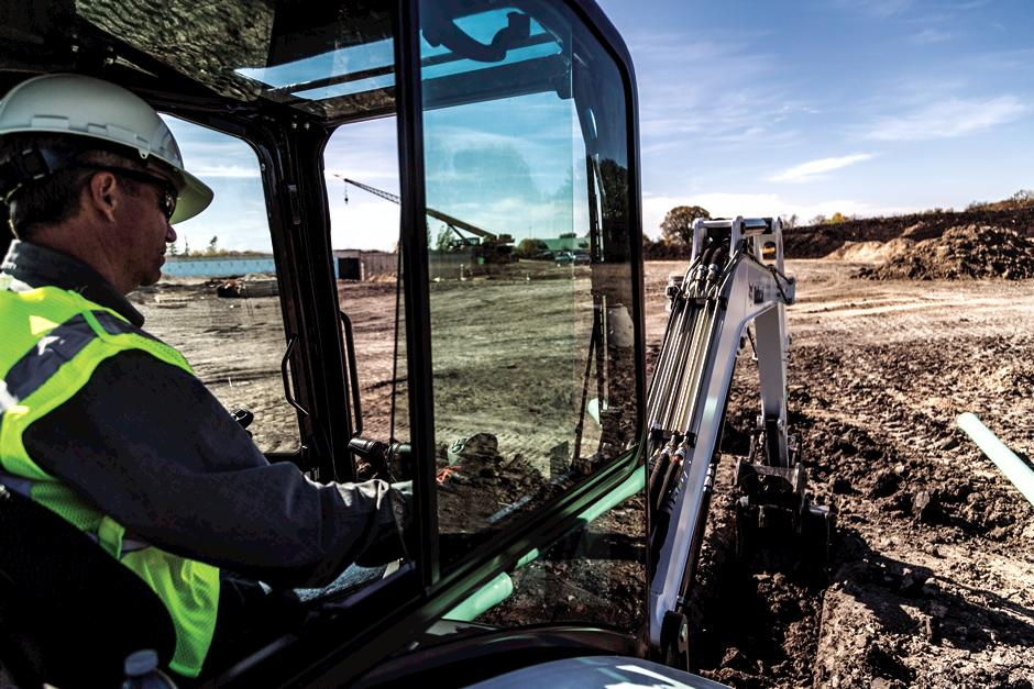Operator Using A Bobcat E35 Compact Excavator To Dig A Trench For Piping.