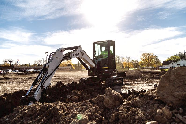 Bobcat R-Series E35 compact (mini) excavator with breaker attachment breaking up concrete driveway
