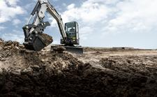Bobcat E35 compact excavator with bucket.