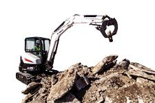Bobcat E35 compact (mini) excavator and Pro Clamp system sorting concrete debris.