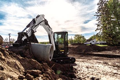 Bobcat E35 R-Series compact excavator moving pipe with the pro clamp system