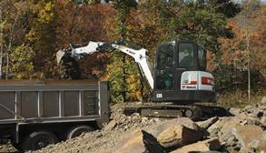 Bobcat E35 compact (mini) excavator loading dirty into a truck.