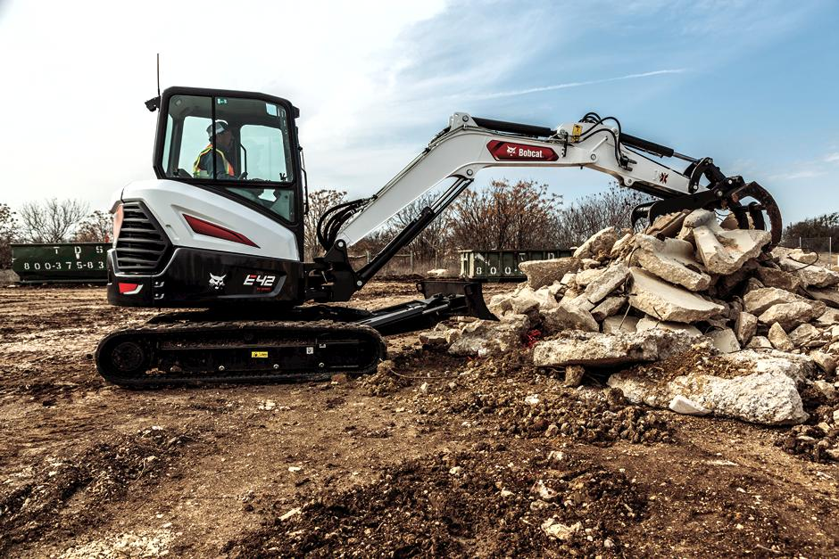 Operator Using Bobcat Mini Excavator Arm To Move Material