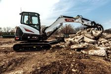 Customer Using Bobcat Mini Excavator To Move Large Material