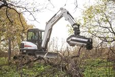 Bobcat E45 compact (mini) excavator with a flail cutter attachment