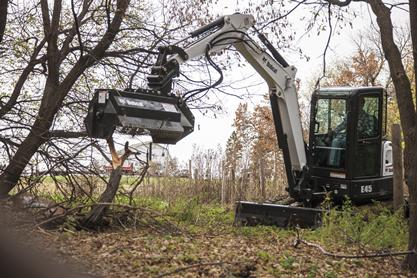 Bobcat E45 compact excavator (mini excavator) with flail mower.