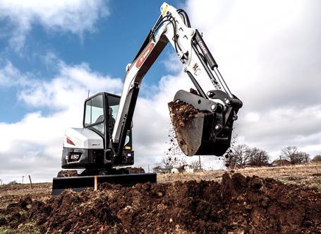 Operator Using Bobcat E50 Mini Excavator To Dig On Jobsite