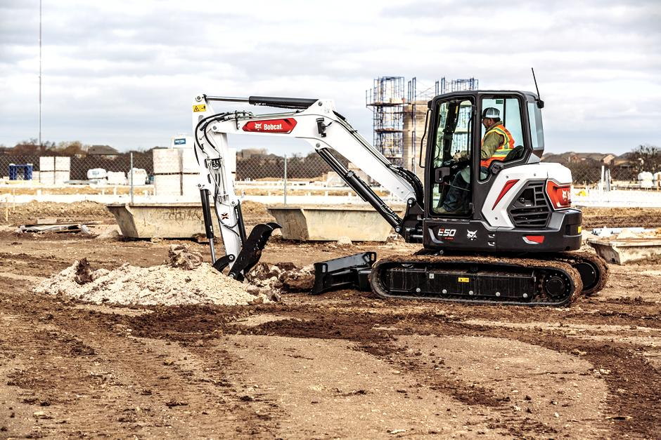 Operator Digs With Bucket Attachment On Bobcat R2-Series Mini Excavator