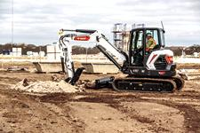 Customer Using R2-Series E50 Compact Track Loader To Trench Jobsite
