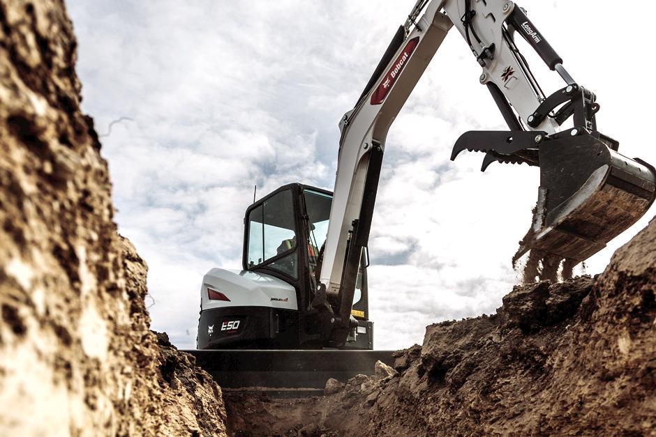 R2-Series E50 Compact Excavator Using Depth Check System To Trench
