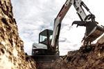 E50 Mini Excavator Using Depth Check To Trench