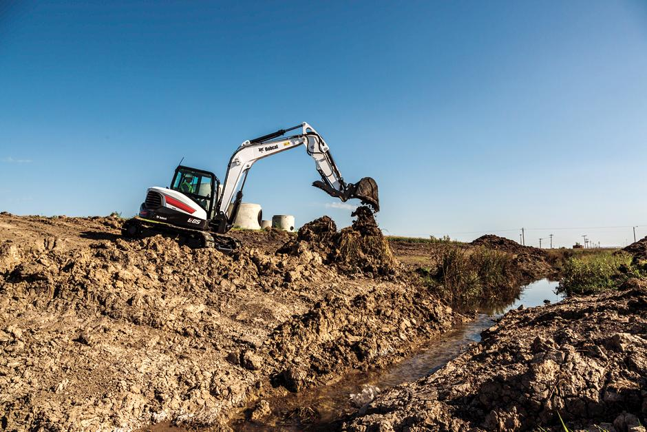 Bobcat R-Series Excavator with clamp attachment on a construction site.