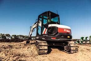 An E85 Bobcat Excavator on a job site.
