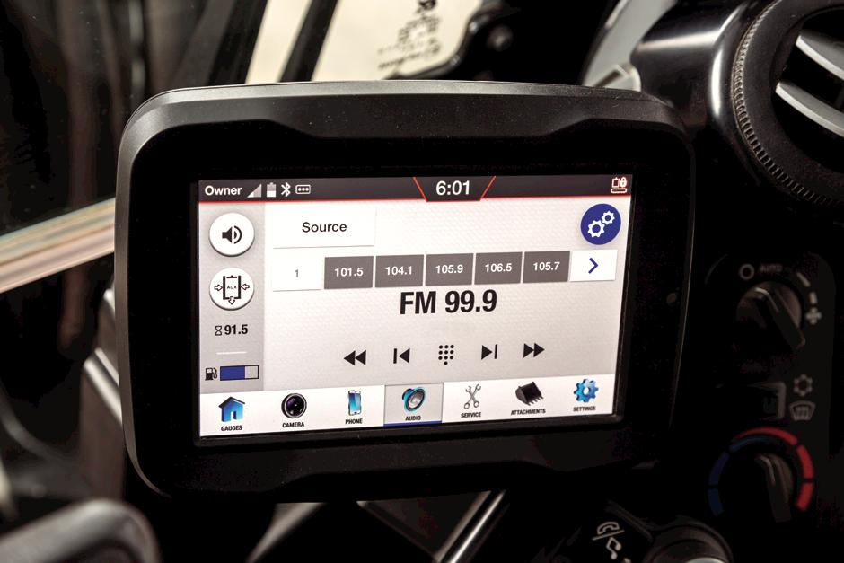 R2-Series Compact Excavator Touch Display Showcasing Radio Integration