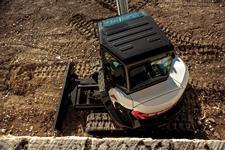 Bobcat E50 Minimal Tail Swing Excavator Next To Stone Wall