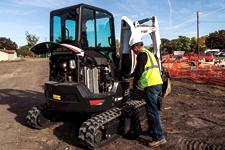 Bobcat compact (mini) excavator with open tailgate and side access hood.
