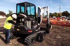 Bobcat E35 compact (mini) excavator gets a routine inspection on a jobsite.