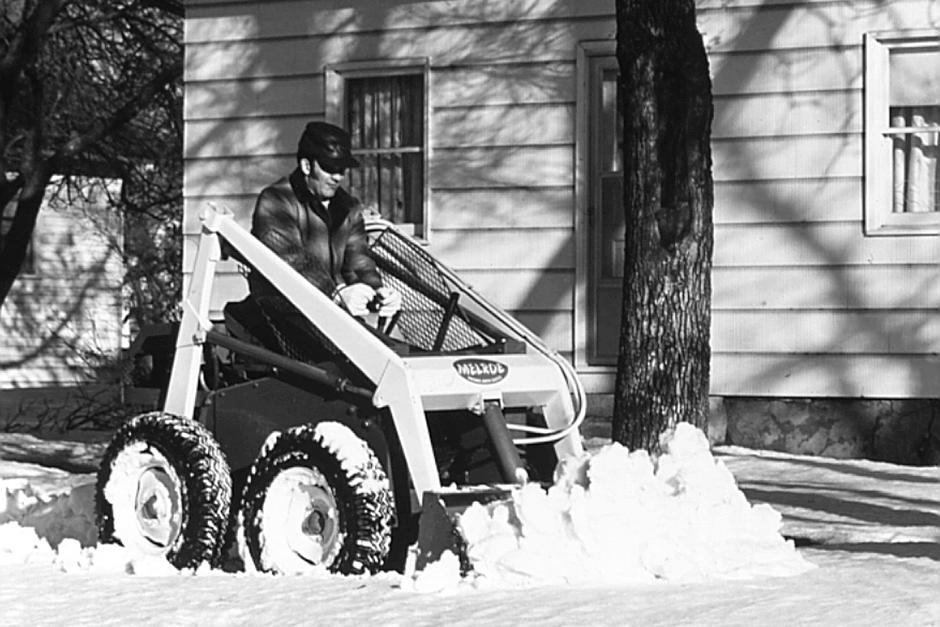 A Historical Photo Of A Melroe Skid-Steer Loader Moving Snow