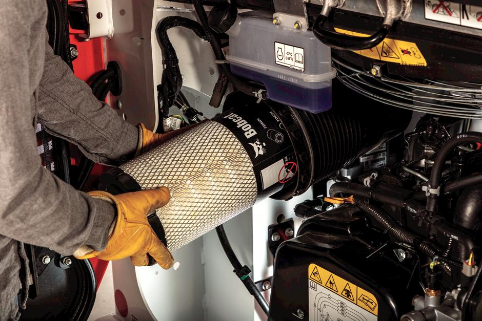 Owner Replacing Air Filter Inside R-Series Compact Loader