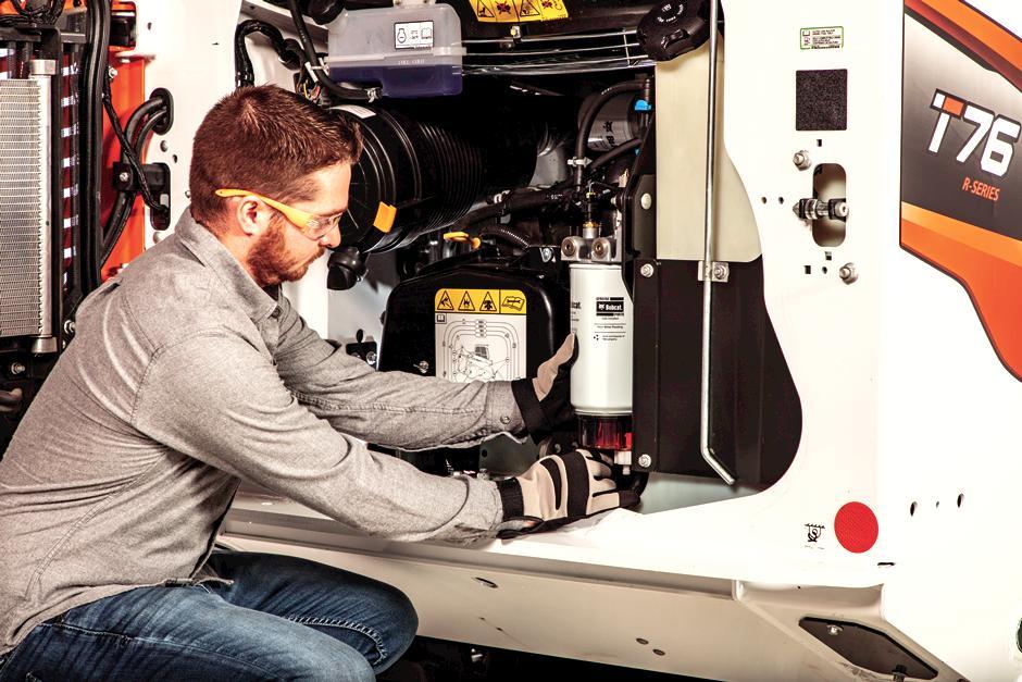 Customer Replacing Fuel Filter Inside Bobcat Compact Loader