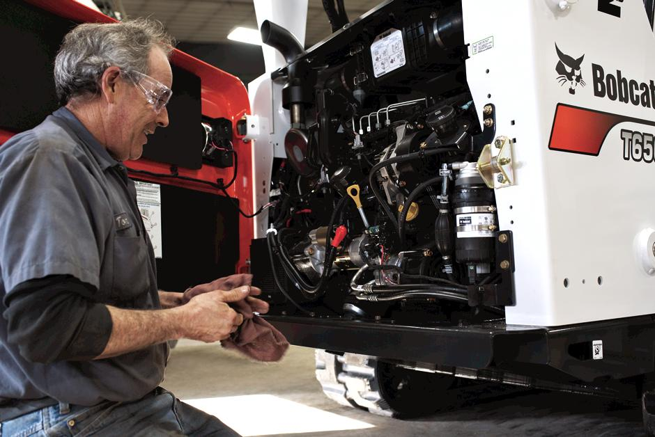 Bobcat Dealership Service Technician Performs Maintenance On A Bobcat Compact Track Loader