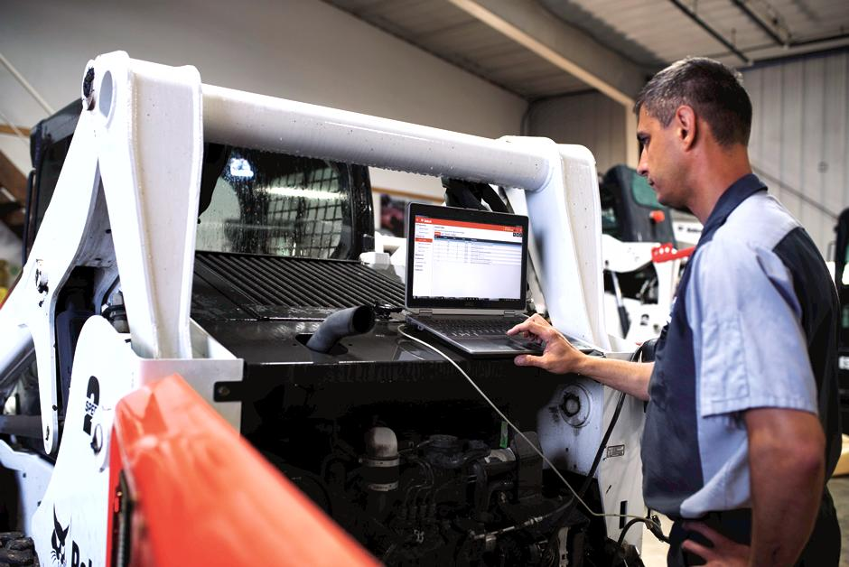 Bobcat Service Technician Running Diagnostics On Compact Track Loader Covered By Protection Plus Extended Warranty