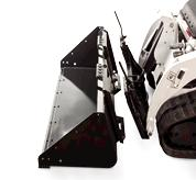 Close-Up Image Of Mini Track Loader With Bob-Tach Mounting System Hooking Up Pallet Fork Attachment