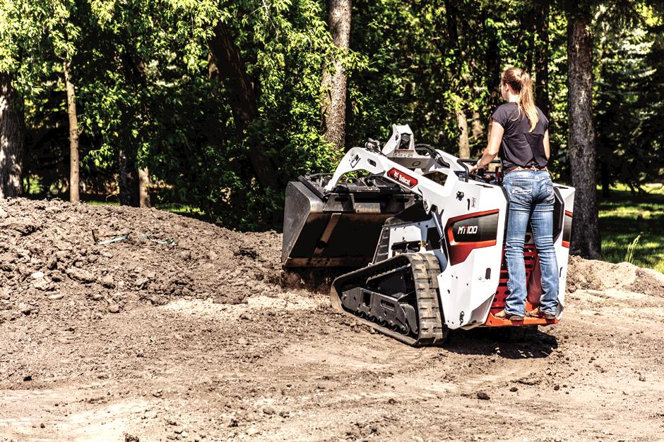 Landscaper Moves Dirt Using Mini Skid Steer With Bucket Attachment