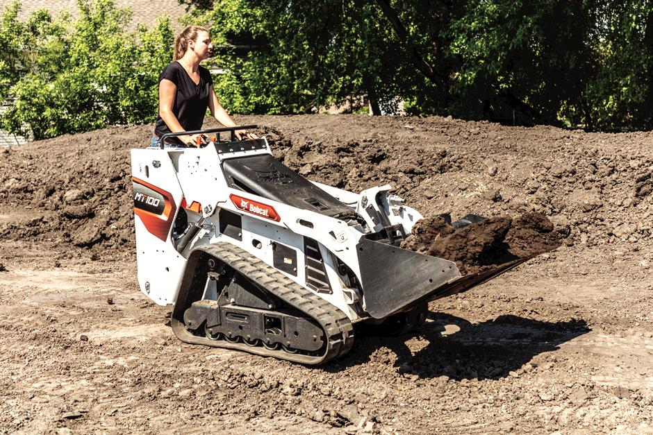 Bobcat Customer Using MT100 Mini Track Loader With Bucket Attachment To Move Dirt On Construction Jobsite