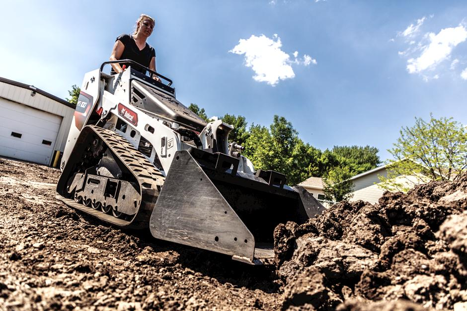 Landscaper Uses Bobcat MT55 Walk-Behind Loader To Move Rocks From Pile.