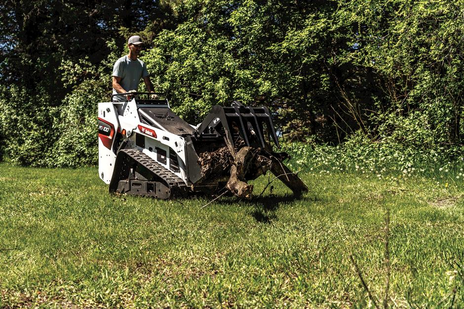 Landscaper Uses Mini Track Loader With Industrial Grapple Attachment To Move A Large Branch