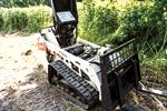 The serviceable components inside a Bobcat mini track loader