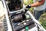 The serviceable components inside a Bobcat mini track loader.