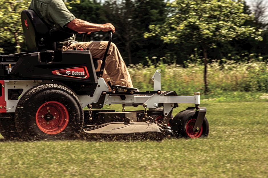 Bobcat ZT3000 Zero-Turn Mower In-Action With Grass Flying Out Of Discharge Chute