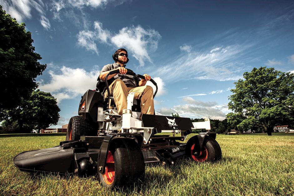 Bobcat ZT3500 Zero-Turn Mower In Action Outside A Barn