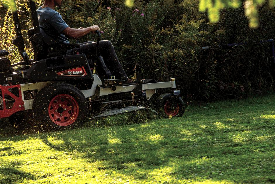 Bobcat ZT3500 Zero-Turn Mower In Action With Grass Flying Out of Discharge Chute