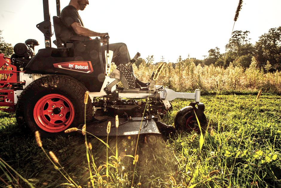 Bobcat ZT7000 Zero-Turn Mower Cutting Grass At Sunset