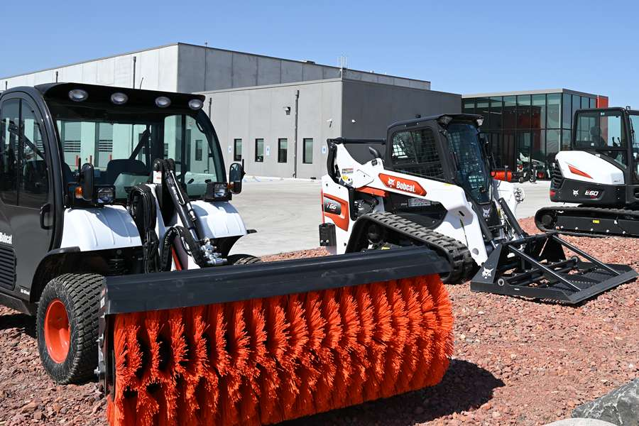 Exterior Shot Of A Bobcat Dealership With Equipment On Display.