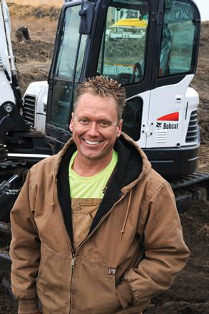 Scott Wiese with a Bobcat Excavator