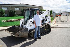 John Rish with Bobcat loader