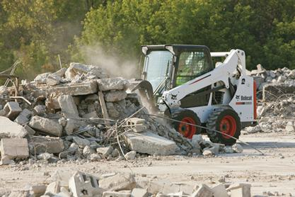 Bobcat S530 skid-steer loader with grapple attachment.