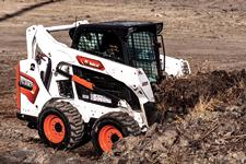Bobcat S590 On Construction Site Digging Into Dirt