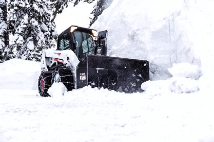 Bobcat S630 skid-steer loader clears snow with a snowblower.