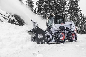 A Bobcat S630 skid-steer loader clears snow.