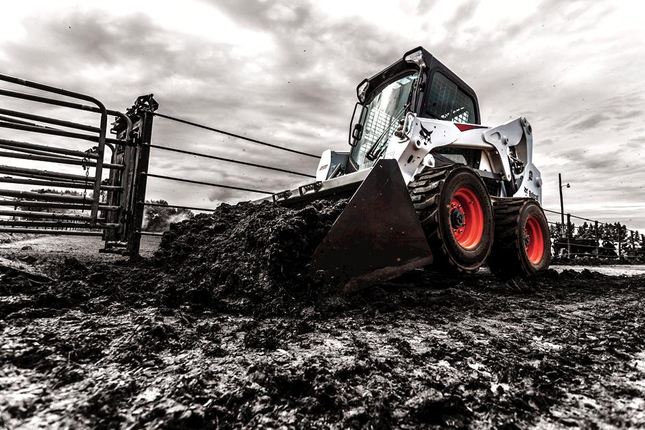 Bobcat S650 moving dirt.