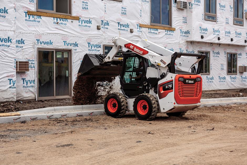 Bobcat Skid-Steer Loader With Cast-Steel Lift Arms And Bucket Attachment